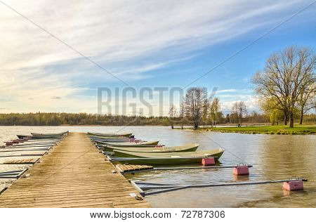 Rowboats Tied To A Wooden Pier