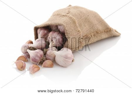 Garlic In A Sack On A White Background