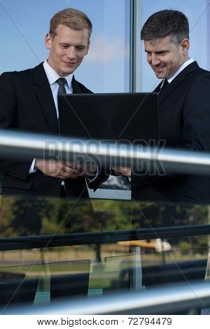 Buisnessmen With A Laptop