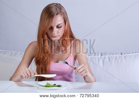 Girl Eating Very Small Lunch