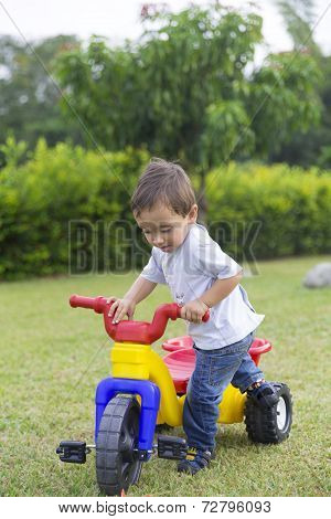 Happy Little Boy Driving His Toy