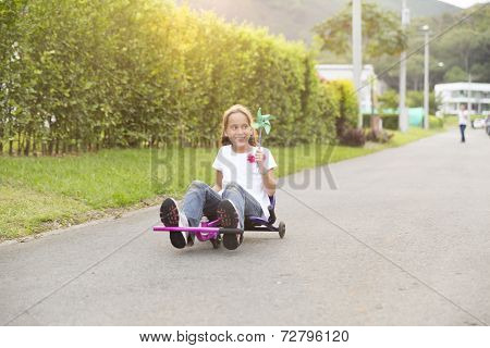Happy Little Girl Driving Her Toy