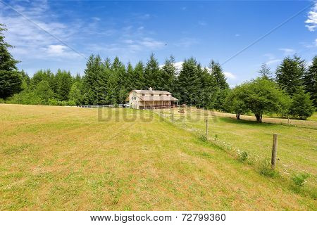 Large Farm Field With Empty Horse Barn