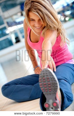 Woman At The Gym Stretching
