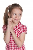 stock photo of shy girl  - A portrait of a shy pretty little girl against the white background - JPG