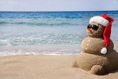 image of snowmen  - Snowman made out of sand - JPG