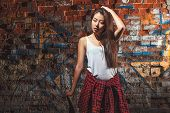 stock photo of skate board  - Beautiful Asian teen girl with skate board - JPG