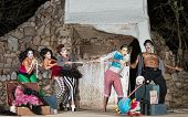 pic of tug-of-war  - Group of silly cirque clowns playing tug - JPG