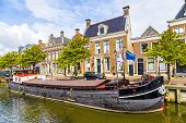pic of pontoon boat  - old boats in a canal in Harlingen - JPG