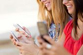 pic of chat  - Portrait of three girls chatting with their smartphones at the park - JPG
