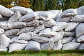 pic of sandbag  - Sandbags for flood defense or military use - JPG