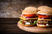 picture of gourmet food  - Beef burgers on the wooden background with blank space on left side