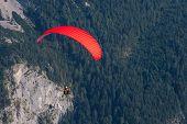 stock photo of parachute  - Extreme parachuting in high mountains Alps Austria - JPG