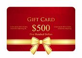 stock photo of exclusive  - Exclusive golden gift card with red ribbon and vintage floral pattern - JPG