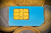 picture of micro-sim  - sim card and euro coins money close up - JPG