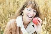 picture of 55-60 years old  - A Woman on wheat have good time - JPG