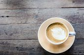 foto of latte  - coffe latte cup on a wood table - JPG