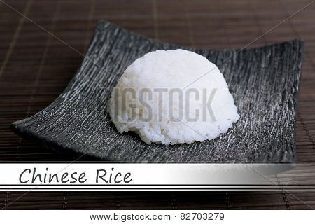 Chinese rice on plate on bamboo mat background and space for your text