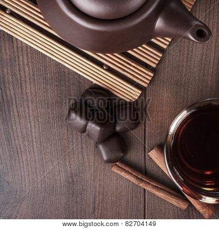 cup of tea with cinnamon sticks and sweets