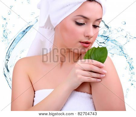 Beautiful young woman with with green leaves on abstract blue water splashing background