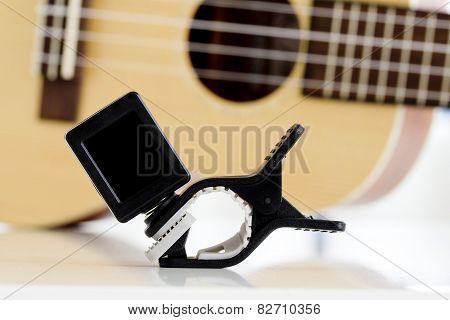 Clip Tuner Equipment For Tuning The Ukulele Guitar Sound.