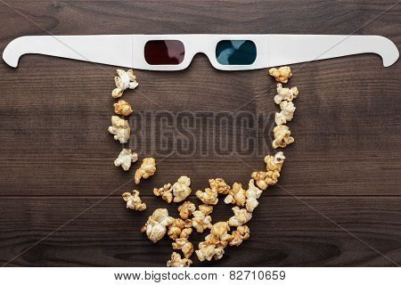 anaglyph glasses and popcorn making bearded face