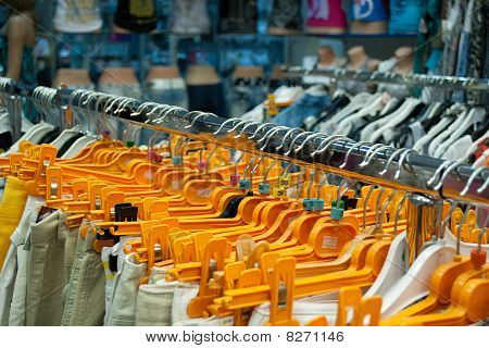 Clothes Hangs On Orange Hangers