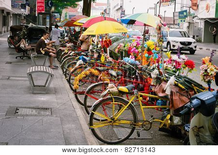 Malaysia, Penang, Georgetown - Circa Jul 2014: Colorfully Decorated Cycle Rickshaws Or Pedicabs Wait