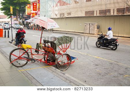 Malaysia, Penang, Georgetown - Circa Jul 2014: Pedicab Parked On The Curb Along A Typical Street In