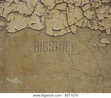Dirty Beige Brown Wall With Some Peeling Blathering Paint At The Top
