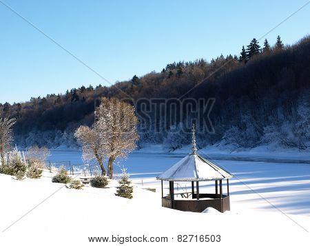 Gazebo by the river in winter
