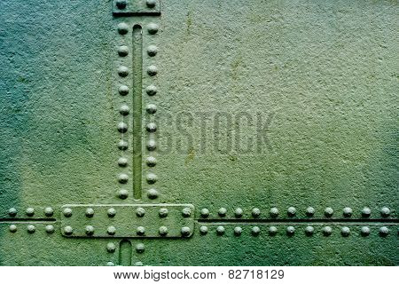 Grunge metal plate with rivets as background
