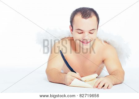 Little angel man with wings writing a letter