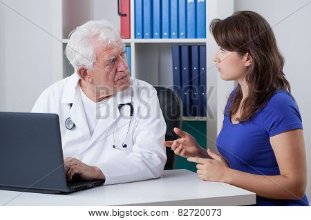 Woman And Senior Physician