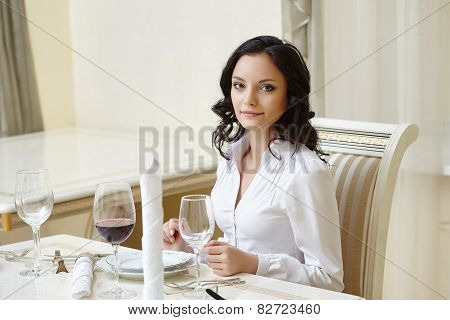 Good-looking woman posing during business lunch