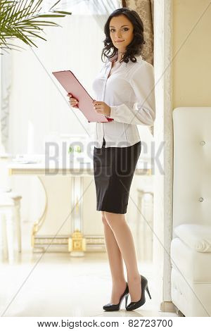 Image of good-looking hostess at restaurant