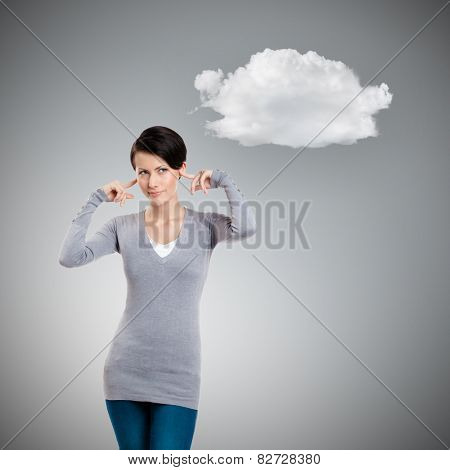 Closing ears with fingers, isolated on grey