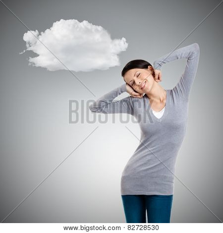 Attractive woman stretches herself, grey background