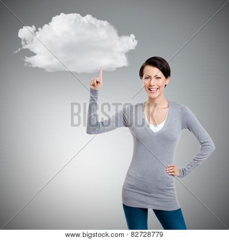Woman shows forefinger, attention sign, isolated on grey background with cloud