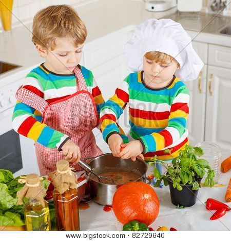 Little Twins Cooking Italian Soup And Meal With Fresh Vegetables