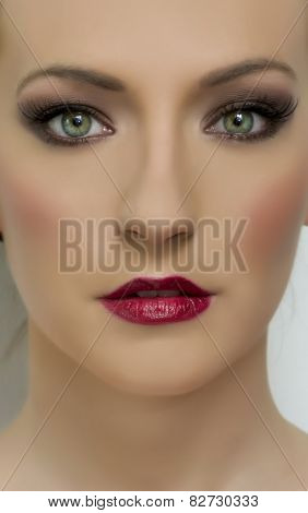 Close Up Portrait Of Beautiful Woman Model With Dark Makeup. Fashion Shiny Highlighter On Skin, Sexy