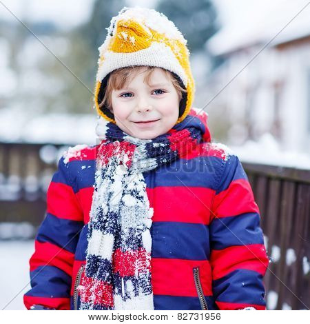 Portrait Of Little Child In Colorful Clothes In Winter, Outdoors