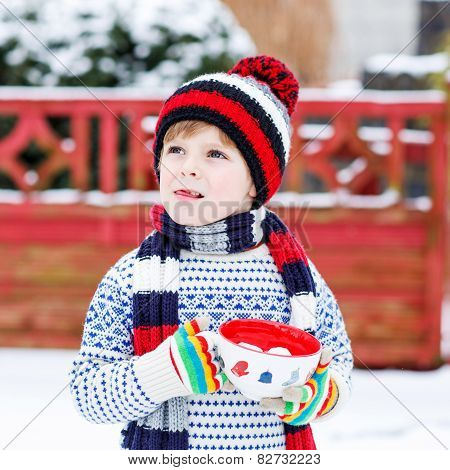 Funny Little Child Holding Big Cup With Snowflakes And Hot Chocolate Drink And Marshmallows