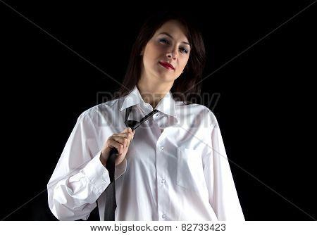 Portrait of woman pulling tie