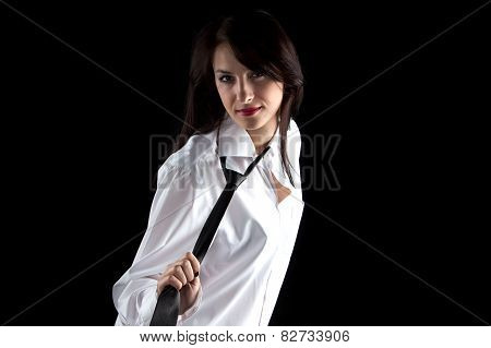 Photo of woman pulling tie
