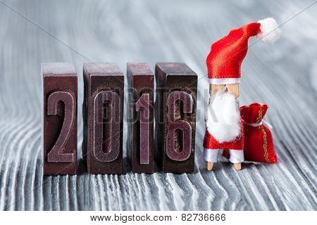 2016 Year. Written With Colored Vintage Letterpress. Christmas Concept - Clothespin Santa Claus With