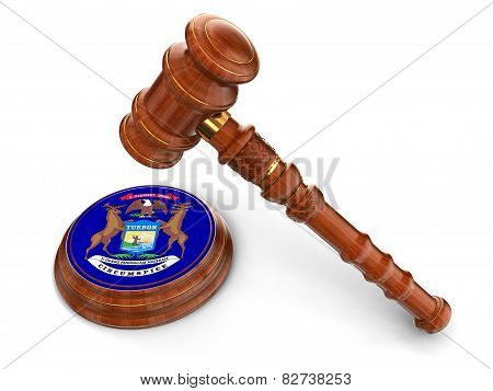 Wooden Mallet and flag Of Michigan (clipping path included)