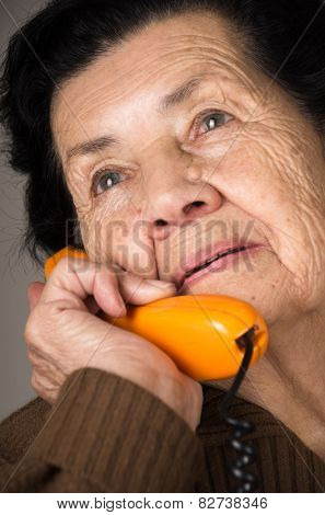 portrait of grandmother old woman talking on the phone