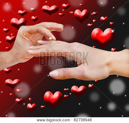 Man making proposal with the ring his girlfriend. Put ring on hand. background with hearts