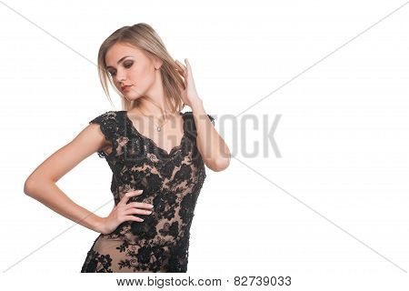 Trendy young woman in guipure dress